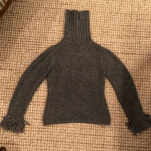 Gray poly/wool sweater with fringed cuffs.  Size 8